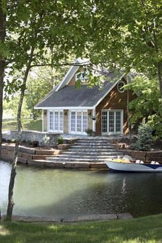 Lake House Cottage. Love the steps that lead right to the water and boat.