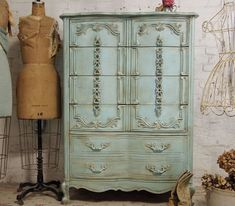 Gorgeous blue cupboard and old dress form - love!