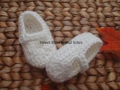 Crisp white handmade crochet baby Mary Janes shoes are perfect with Easter outfits!    Please stop by my Etsy shop at www.etsy.com/shop/sweetheartsandsoles for more baby booties, as well as baby and toddler accessories!