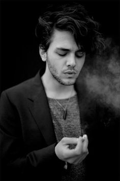 men who smoke in real life i am not attracted to. men in pictures who are smoking, well, that's a whole new story.