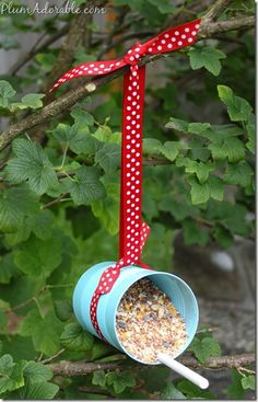 Soup can bird feeders. Cute for recycling! And a kids craft. So many possibilities.