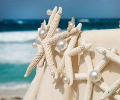 Starfish and pearls are draped around the edge of the table.