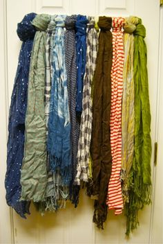 A great way to display all those scarves I have! Use a curtain rod on the door or wall to hang your scarves so that you can see what options you have for acessories! I need this in my closet!