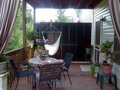 My sister in law Debra - did a great job decorating her deck -by using louvered closet doors to block view of neighbors!  love it