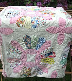 Reserved for Elaine.........Vintage quilt top, dresden plate, feedsack fabrics hand stitched. $120.00, via Etsy.