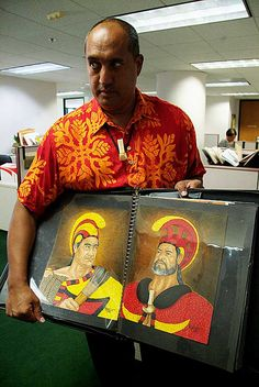 Brook Kapūkuniahi Parker shows two illustrations from his portfolio. Parker has been tapped by Kamehameha Publishing to illustrate historical figures from Ruling Chiefs of Hawaii by S.M. Kamakau. Photo: Blaine Fergerstrom
