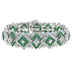 Art Deco Bracelet with diamonds and emeralds...pretty glam!