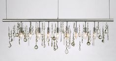 Create some crystal strands from a craft store, add some lighting & voila, an incredible new chandelier!