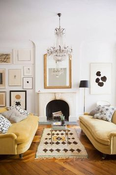 Living room with two yellow sofas | photo brittany ambridge for domino