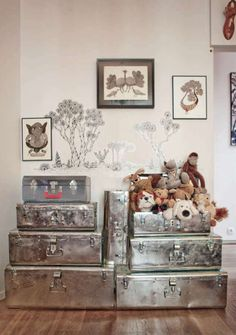 Inspired. Photo from Milk Magazine.  Storage trunks painted in metallic colors.