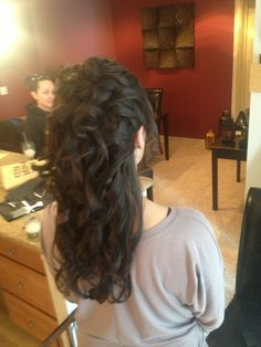 Updo on extra long, dark brunette hair.