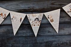 Children's book page flag pennants. Love the idea of using a pictures book. Would be perfect for a kid's birthday party.