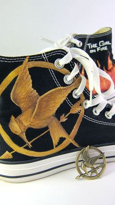 Hunger Games Converse high-tops. Wow. Ahhhhh! I love converse and the Hunger Games! I want these so bad now!
