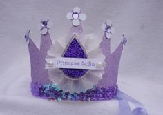 Sofia the First Party Crown Birthday Hat in lavender, white and amythyst purple amulet with pearl glitter. $14.50, via Etsy.
