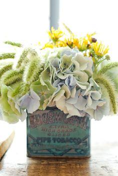 flower arrangement in a tin can