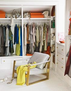"""Designer Windsor Smith: """"I had a little fun with that midcentury modern chair in my dressing room. I loved the frame and had it replated in matte gold, and reupholstered the seat in silvery leather."""" #closet #dressing_room #midcentury #organization"""