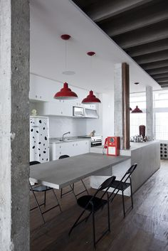 red lights black white industrial style kitchen concrete worktop table