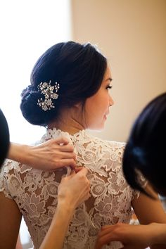 An #updo with a brooch is perfect with a high-necked wedding dress | Michelle VanTine Photography | Brides.com