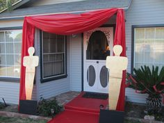 Red Carpet Birthday Party on a Budget. Cardboard was free from Lowes, used a table cloth roll for curtain and red carpet, spray paint for statues was inexpensive.
