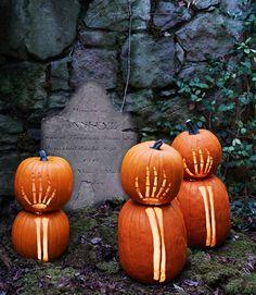 Skeleton hand carved pumpkins