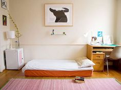 Maybe you don't want to go as far as ditching your bed frame but you can still opt for a peaceful, minimalistic look with clean lines and a neutral color palette, punctuated by pops of color.