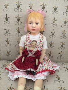A recent effort, an original sculpted doll, chalked with pigments with a few painted details. This doll will be my granddaughter's. Her other grandmother wants to sew some clothes!