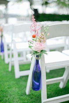 Pretty pink and blue wedding ceremony chair decor, photo by Harwell Photography | via junebugweddings.com