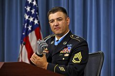 During a press conference following his induction into the Pentagon's Hall of Heroes, July 13, Medal of Honor recipient, Sgt. 1st. Class Leroy Petry describes in detail the combat action of May 26, 2008, near Paktya, Afghanistan, during which he distinguished himself by conspicuous gallantry in saving the lives of two fellow Rangers. Petry's right hand was traumatically amputated during the fight and he now uses a state-of-the-art prosthesis, which allows him amazing dexterity. Photo by Robert D. Ward