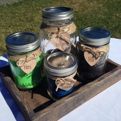 Unity sand ceremony.  Their son Joshua participated by dumping his blue sand into the larger mason jar!