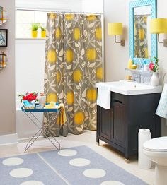 Pops of mustard yellow and sky blue make this bathroom feel fresh and trendy. More bathroom color schemes: http://www.bhg.com/bathroom/color-schemes/colors/bathroom-color-schemes/?socsrc=bhgpin072113bluemirror=6