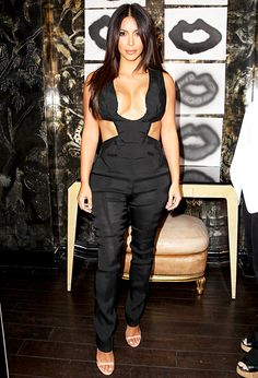 Kim Kardashian turned heads when she stepped out in LA wearing a boundary-pushing take on the jumpsuit. Take about sideboob! Click through to find out how much this look cost!