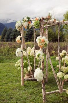 birch and hydrangea wedding ceremony arch with mountain views