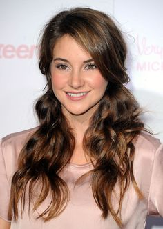 A soft and pretty half updo for long wavy hair, seen here on Shailene Woodley at the 8th Annual Teen Vogue Young Hollywood Party.