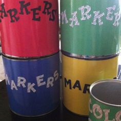 Recovered coffee cans to hold markers and pencils.