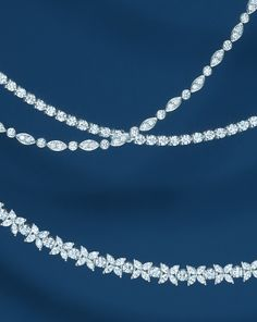 Weather report? Frosty. Diamond necklaces in platinum with diamonds: Tiffany Victoria™, Tiffany Jazz™ and diamond line.