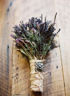 This wedding bouquet is another great idea for a vintage wedding.  Just take fresh lavender stems and rosemary wrap with satin and add a vintage brooch better yet, a brooch that belonged to your grandmother.