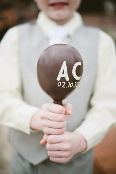 monogrammed maracas get the guests in the spirit for a wedding south of the border  Photography by http://jillianmitchell.net/, Event Design and Planning by http://thedazzlingdetails.com