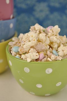 8 C of popped popcorn  1 lb. white chocolate, almond bark or melts  2 C Fritos, crushed  M & M's  Put popped corn and crushed Fritos into bowl.  Melt chocolate in microwave.  Pour melted chocolate over popcorn mixture and stir to coat completely.  Pour onto a was paper or parchment paper lined cookie sheet and allow to cool and dry.  Enjoy!!  Don't blame me if you eat the whole bowl yourself.