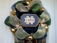 I want a wreath for our door for football season!  Notre Dame Fighting Irish Deco Mesh Wreath. $30.00, via Etsy.