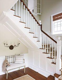 "paneled stairs -Foyer and stair rug (sisal): Stark Carpet Corp., 212/752-9000, starkcarpet.com  Wall paint (""Manchester Tan"" #HC-81); trim paint (""Dove White"" #OC-17): Benjamin Moore & Co., 888/236-6667"