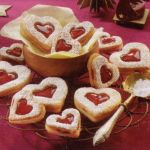 Linzer cookies - a take-off from the traditional Linzer Torte. food recipes, german recipes, chocolate chips, heart cookies, white chocolate, decorated cookies, german food, linzer heart, german christmas