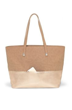 Your everyday, go-to tote that makes a savvy statement and a Packing List necessity! Bond Street Tote by Stella Dot