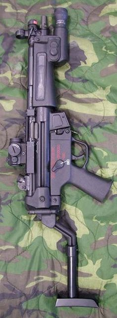 HK MP5 - with B Helmet Stock, Aimpoint Micro T-1, Laser Devices LDITL tactical light foregrip and laser aiming module plus single point sling