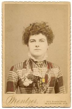 Cabinet card of an attractive young Victorian woman wearing jewelry and a large floral corsage. #Victorian #vintage #women #portraits