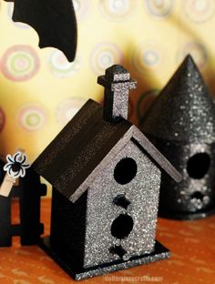 Dollar Store birdhouses, painted black & glittered for Halloween. Fabulous!