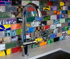 What!? Old skateboards find new uses - such as tiles that created this backsplash - thanks to Art of Board.