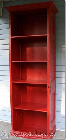 tall red bookshelf made out of an old door