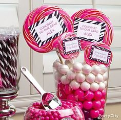 Personalized lollies! Just add custom-printed stickers. Click for more pink & zebra graduation party ideas!
