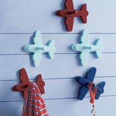 I love these adorable airplane wall pegs for encouraging kids to hang things up. For more tips and ideas to get kids organized visit http://getkidsorganized.net