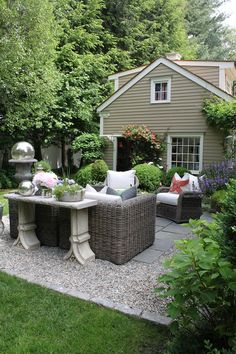 stone and gravel patio, pretty arrangement with console behind seating